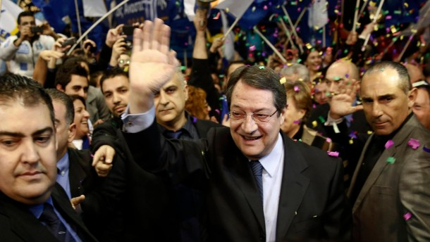 Nicos Anastasiades, Cyprus presidential candidate of the right wing Democratic Rally party, is cheered by supporters during a pre-election rally in Nicosia
