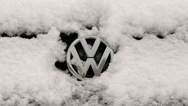 File photo of snow-covered Volkswagen logo at a Volkswagen car dealer in the western city of Hamm