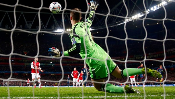 Bayern Munich's goalkeeper Neuer saves a penalty from Arsenal's Ozil during their Champions League round of 16 first leg soccer match at the Emirates Stadium in London