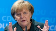 """Bundeskanzlerin Merkel verspricht auf dem Bundesausschuss der CDU in Berlin, """"große Aufgaben auch wirklich zu bewältigen""""."""