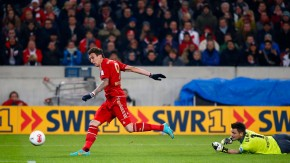 Mandzukic of Bayern Munich scores a goal against goalkeeper Ulreich of VfB Stuttgart during their German first division Bundesliga soccer match in Stuttgart