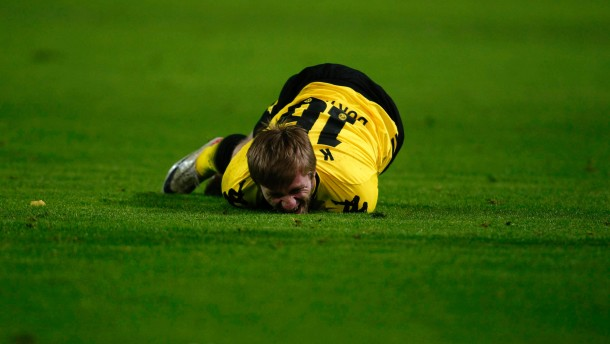 Borussia Dortmund's Blaszczykowski lies on the ground during their Group F Champions League soccer match against Olympique Marseille in Dortmund