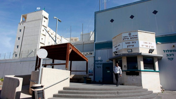 An Israeli prison guard stands outside Ayalon prison in Ramle near Tel Aviv