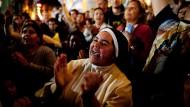 In der Kathedrale von Buenos Aires jubelten die Menschen, als Papst Franziskus zu den Gläubigen auf dem Petersplatz sprach