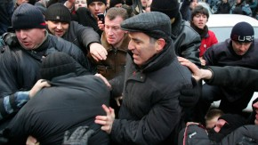 Chess grandmaster and opposition leader Kasparov pushes through the crowd before being detained by the police during a rally in Moscow