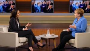 Merkel und der Tisch, über den sie sich nicht ziehen lassen will