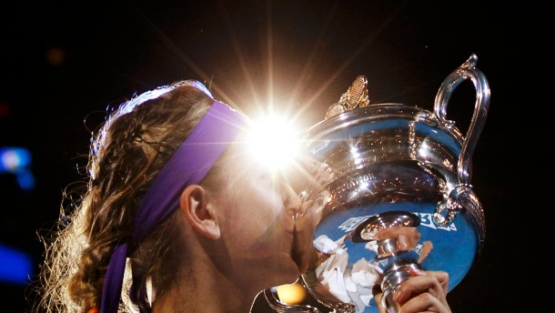 Victoria Azarenka of Belarus poses with the Daphne Akhurst Memorial Cup after defeating Li Na of China in their women's singles final match at the Australian Open tennis tournament in Melbourne
