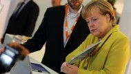 Mit dem Tablet ins Behörden-WLAN? Bundeskanzlerin Angela Merkel könnte dafür sorgen, dass das für jeden möglich wird.