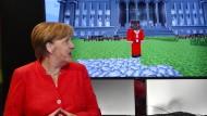 Merkel umschmeichelt die Computerspielbranche