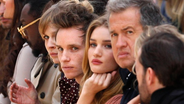 French actress Poesy, British actor Redmayne, British model Huntington-Whiteley and Peruvian photographer Testino watch the Burberry Prorsum 2012 Autumn/Winter collection show during London Fashion Week