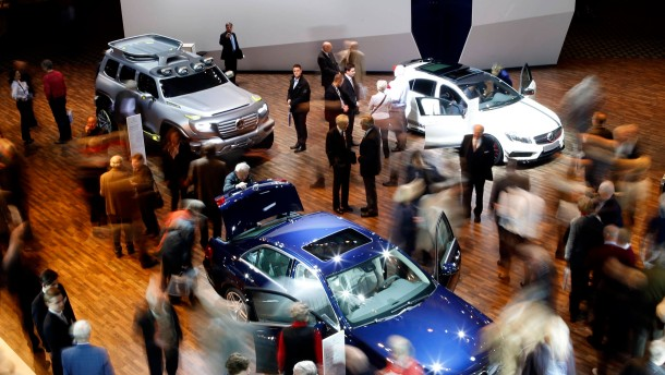 Shareholders look at  Mercendes-Benz cars during Daimler annual shareholder meeting in Berlin