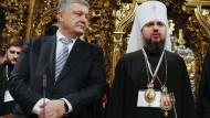Der ukrainische Präsident Poroschenko und der Metropolit Jepifani, der Kopf der neuen Kirche.