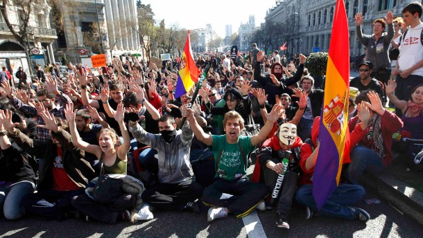 Protesters shout slogans in central Madrid during a general strike in Spain