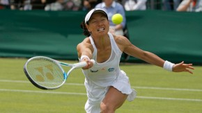 Kimiko Date-Krumm of Japan hits a return to Carina Witthoeft of Germany during their women's singles tennis match at the Wimbledon Tennis Championships, in London