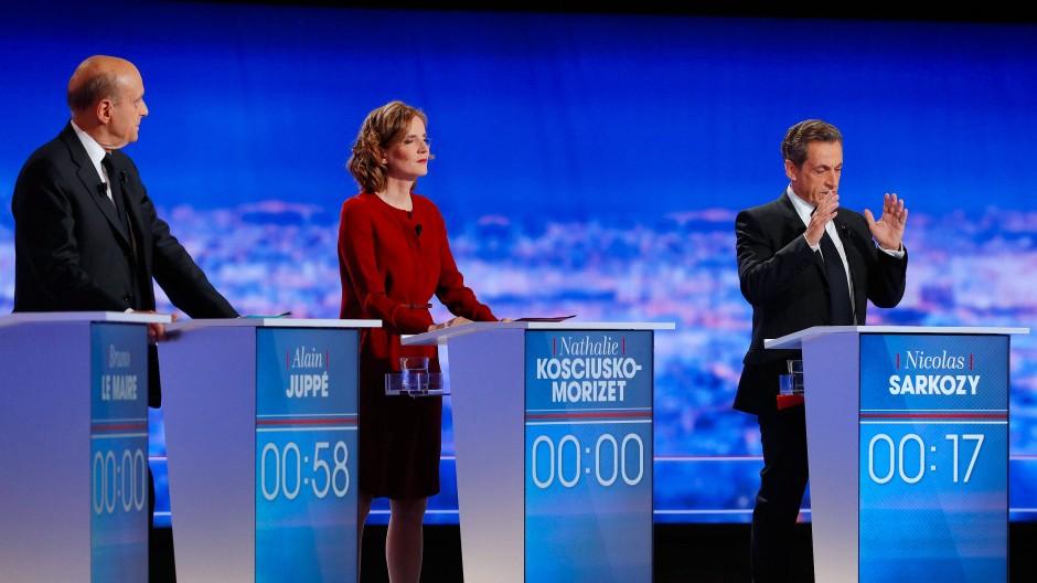 Alain Juppé (links), Nathalie Kosciusko-Morizet und Nicolas Sarkozy bei der Fernsehdebatte am Donnerstag