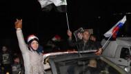 Regierungsanhänger feiern Sieg in Aleppo