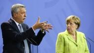 Der Hohe Flüchtlingskommissar der Vereinten Nationen, Filippo Grandi, und Bundeskanzlerin Angela Merkel am Freitag in Berlin