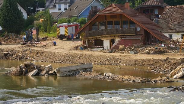 Menschen in Flutregion bereiten sich auf neuen Regen vor