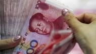 Chinas Devisenreserven schrumpfen im Rekordtempo