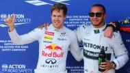 Sind doch dicke Buddies: Lewis Hamilton (r.) rudert in seiner Vettel-Kritik zurück