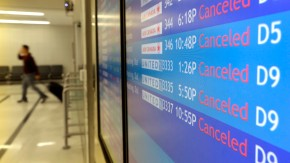 Signs at the empty Philadelphia International Airport list cancelled flights caused by Hurricane Sandy in Philadelphia