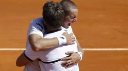 Tennis-Herren schwer erleichtert