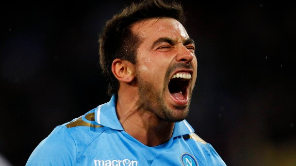 Napoli's Ezequiel Lavezzi celebrates after scoring against Chelsea during their Champions League last 16 first leg soccer match at the San Paolo stadium in Naples