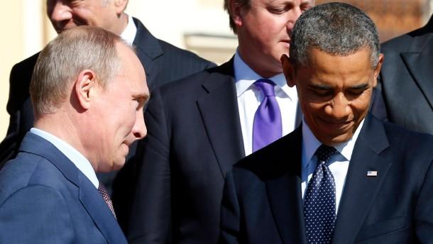 Kommen sich selten so nahe: Die Präsidenten Putin und Obama - eine Begegnung in Sankt Petersburg