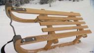Mit dem Davoser Schlitten den Berg hinunter
