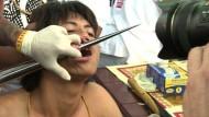 Piercing mit Schaufeln und Autofelge