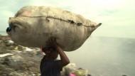 Das Leiden der Müllsammler von Maputo