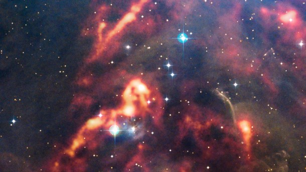 Clouds of cosmic dust in the region of Orion