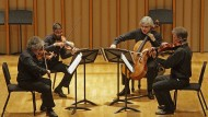 Als es noch Zuhörer gab: Lucas Fels am Violoncello mit dem Arditti-Quartett
