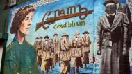 Nordirland war schon immer ein Land des politischen Wandbildes. Rund um das Jubiläum sprießen besonders viele neue Malereien rund um die Falls Road.