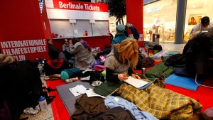 People are seen outside a ticket office, waiting to buy tickets for the upcoming 62nd Berlinale International Film Festival in Berlin