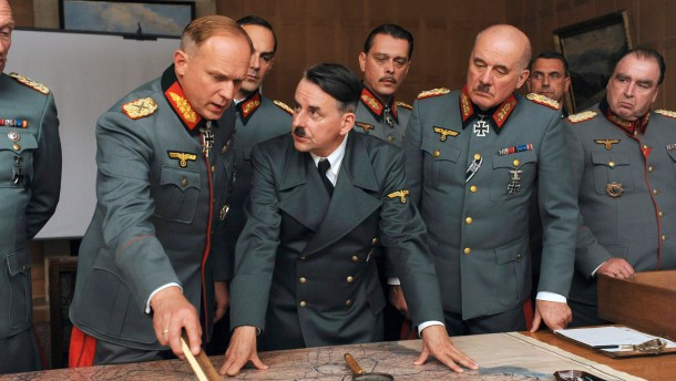 Undated handout picture shows general Rommel played by Tukur explaining to Hitler played by Silberschneider his strategy of defence on west front during the footage of the film 'Rommel'