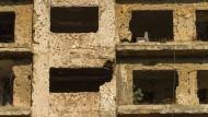 Auch die Stadt, in der die internationale Tagung stattfand, ist noch vom Krieg versehrt: zerschossene Fassade an der ehemaligen Grünen Linie Beiruts.