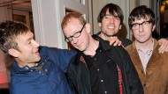 Damon Albarn, Dave Rowntree, Alex James und Graham Coxon sind Blur.
