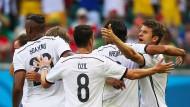 Eine Leidenschaft, eine Mannschaft, ein Tor: Jerome Boateng, Mesut Özil, Sami Khedira und Thomas Müller freuen sich im Spiel gegen Portugal bei der WM in Brasilien im Juni 2014.