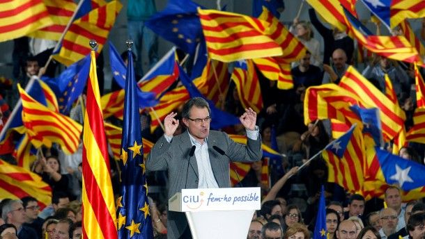 Mas, Convergencia i Unio party's candidate for Catalunya's regional government, gestures during a meeting in Barcelona