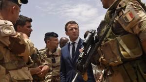Reiseleiter Macron