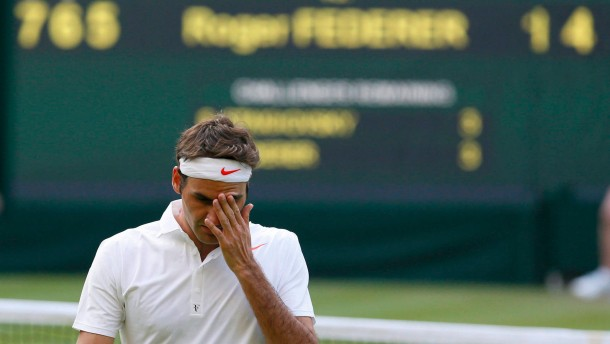 Roger Federer of Switzerland reacts during his  men's singles tennis match against Sergiy Stakhovsky of Ukraine at the Wimbledon Tennis Championships, in London