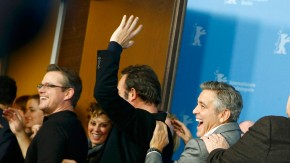 Cast members Murray Goodman Clooney Dujardin and Damon form conga line as they leave after photocall at 64th Berlinale International Film Festival in Berlin