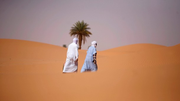 Men walk at Sidi Manssour on the outskirts of the oasis town of Timimoun