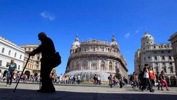 A man walks in De Ferrari square in Genoa