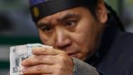 Auch den Chinesen macht der Yuan Sorgen.