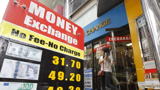 Thai baht currency weaken after Thailand economy has entered rece