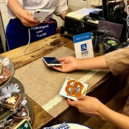 Bezahlen mit Alipay am Münchner Viktualienmarkt