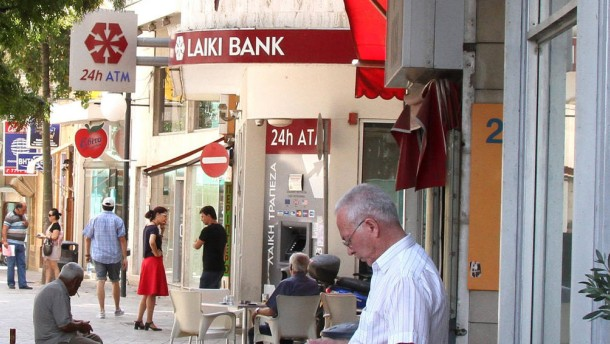 Fitch downgrades Bank of Cyprus, Popular Bank and Hellenic Bank