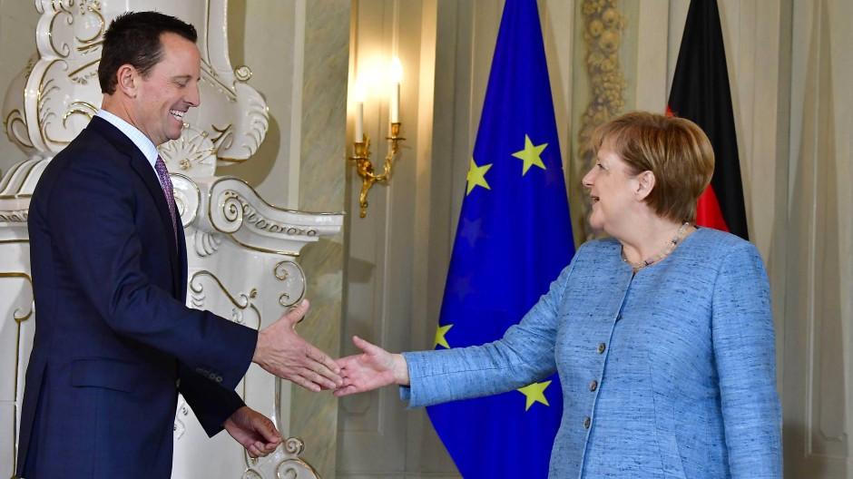 Unterschiedliche Temperamente: Grenell und Merkel im Juli 2018.